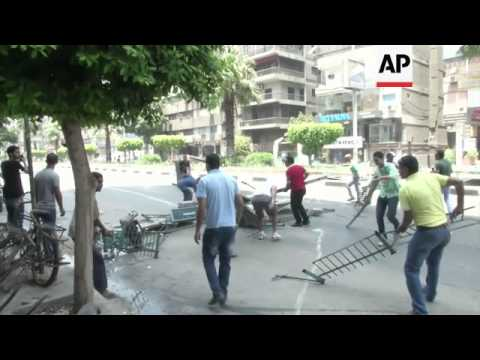 Gunfire during clashes between police  and Muslim Brotherhood protesters