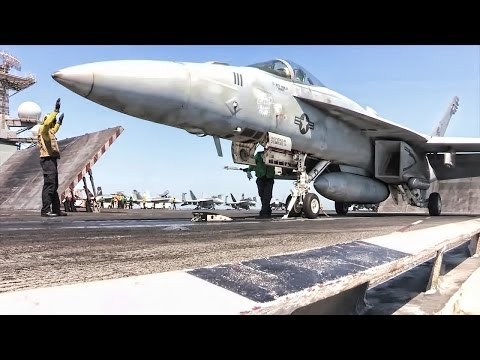 U.S. Aircraft Carrier - Ready To Launch Air Strikes