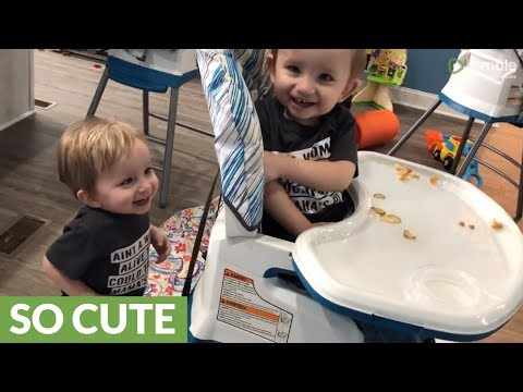 Identical twins adorably giggle over silly game