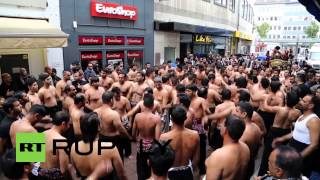 Gambar cover Germany: Watch Shia mourners smash chests for Imam Ali