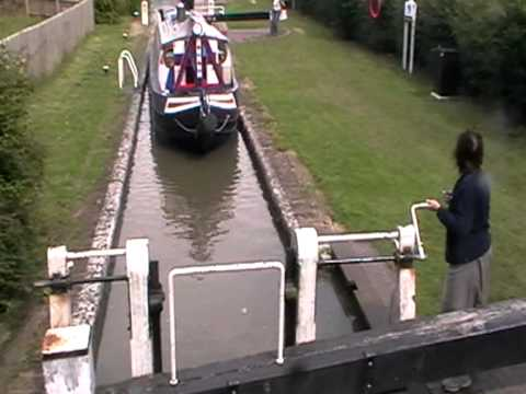 Narrow boats using canal lock.