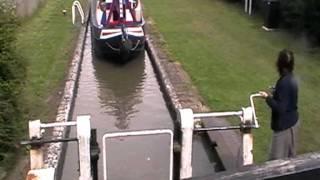 Narrow boats using canal lock.