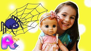 Anna plays with a doll to the song Itsy Bitsy Spider