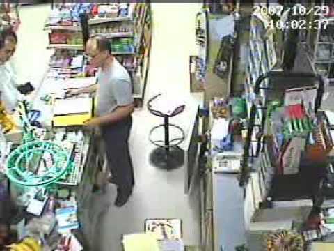 CCTV Footage - Stealing money at Cashier caught by hidden camera!