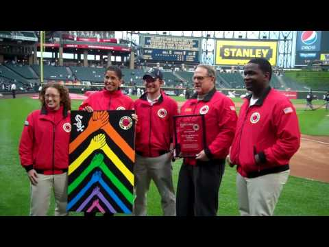 Jerry Reinsdorf, owner of the Chicago White Sox, receives his City Year Red Jacket.