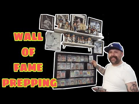 Removing Autograph Baseball Cards From The Wall Of Fame