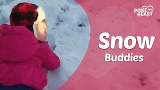 Baby Giggles In Snow With Puppy
