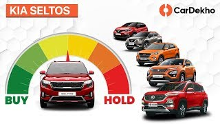 Download Kia Seltos India vs MG Hector, Hyundai Creta & Tata Harrier | Buy or Hold | CarDekho Mp3 and Videos