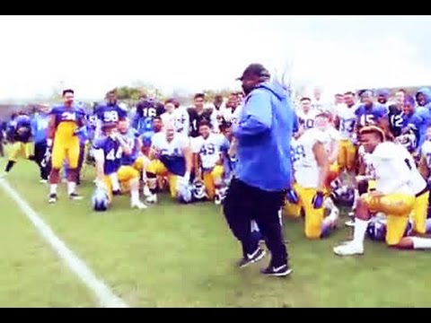 Football coach shows off his dance moves in front of team