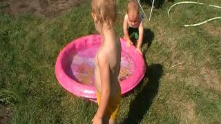 The kids playing in the pool to keep cool!!