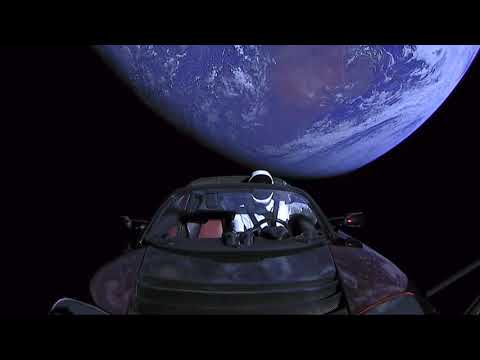 Driving along in my automobile. Tesla Roadster in space.