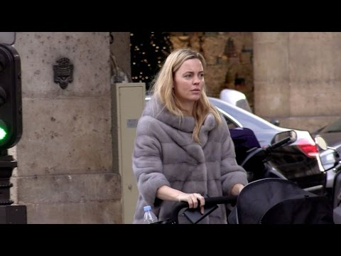 Australian actress Melissa George walking her baby in the streets of Paris