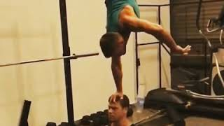 Guys Do Water Bottle Flip While Doing Handstand on Head - 1020399