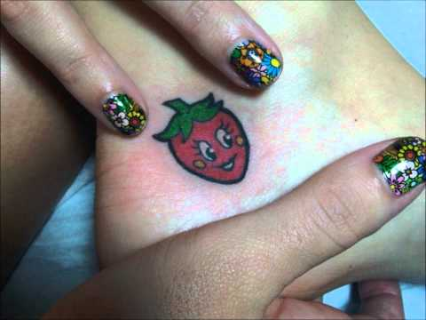 Katy Perry talks tattoos and strawberries.