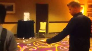 7 year old EXPERT card thrower battles Guinness Record holder Rick Smith Jr. Playing card throwing.