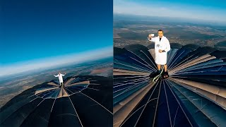 Man Stands On Top Of Hot Air Balloon
