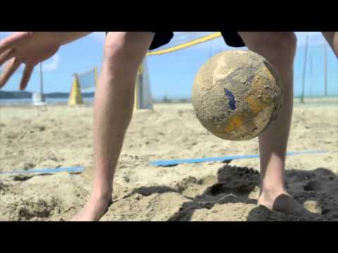 Simon Krakar demonstrates how to clean the volleyball