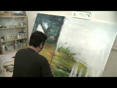 Artist Ali Akbar at work in his studio