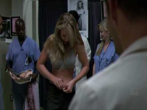 Izzie s Alex her tattoo after he decorated the locker room with Bethany Whisper ads