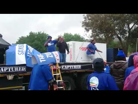 DA march members gather to make their way to Gupta Saxonwold compound