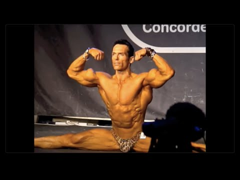 SUPER-FLEXIBLE BODYBUILDER DOING THE SPLITS, GREAT CONDITION