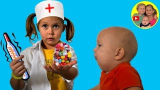 Doctor examines Baby born Denis and gives him vitamins. Playing doctor