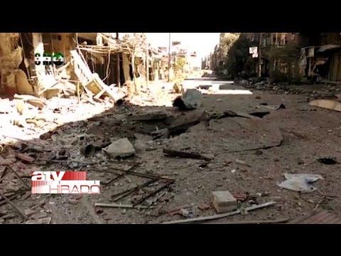 Iraki katonák tömegsírjára bukkantak Tikritben - megrázó képek