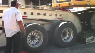 Unload a 100,000 lb Load King trailer