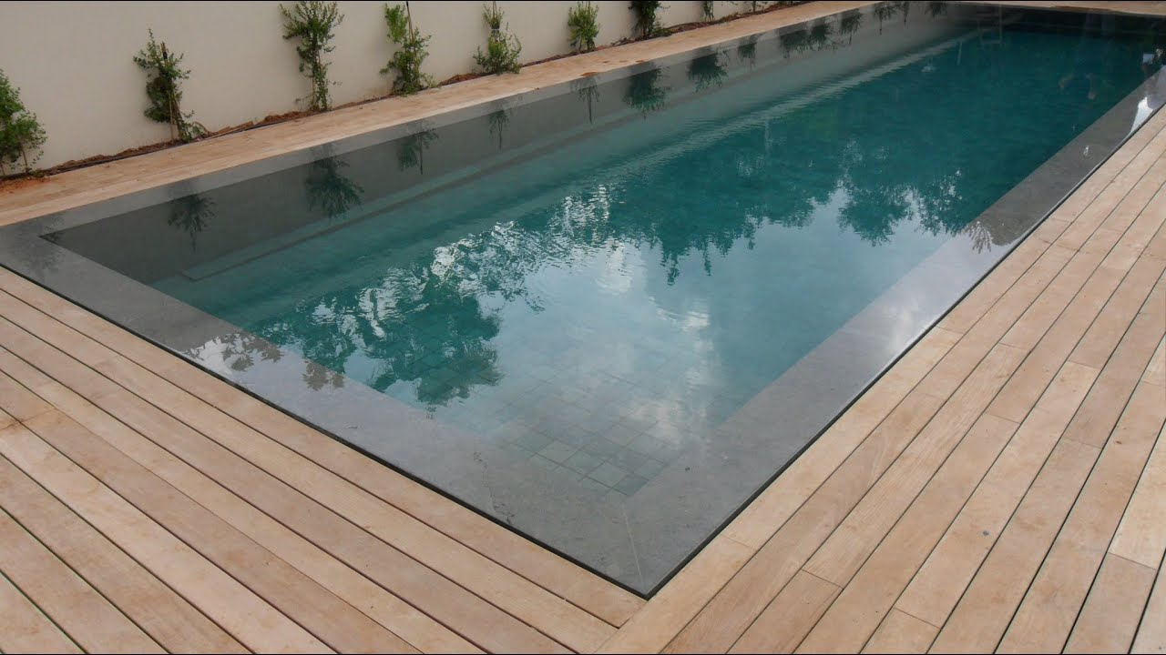 Teak Decking Installation Around Swimming Pool With Hidden