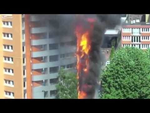 Fire Engulfs the Entire side of a High Rise building