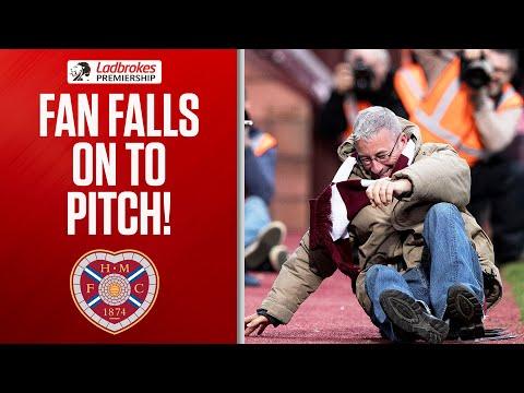 Watch: Hilarious Moment Hearts Fan Falls Through A Gate!   Ladbrokes Premiership