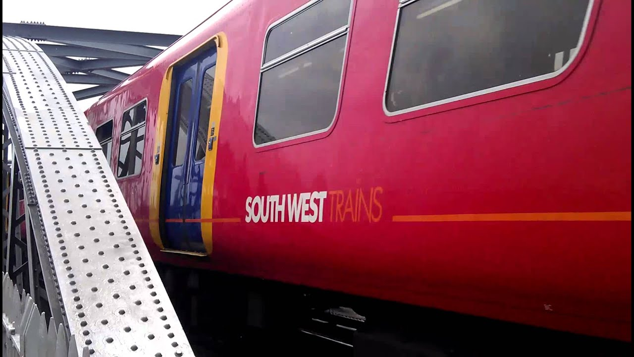 SWT Class 455 EMU passes over Barnes Bridge going to the ...
