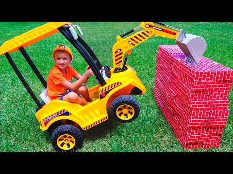 Tractor breaks down the walls - Vlad ride on power wheel to help kid