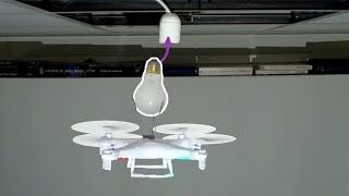 Replacing a lightbulb with a drone by : Marek Baczynski