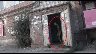 A strange figure captured on camera in a terrible porch