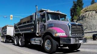 B.C. DUMP TRUCKS #2 -- Various configurations of dump trucks hauling earth through city highways.