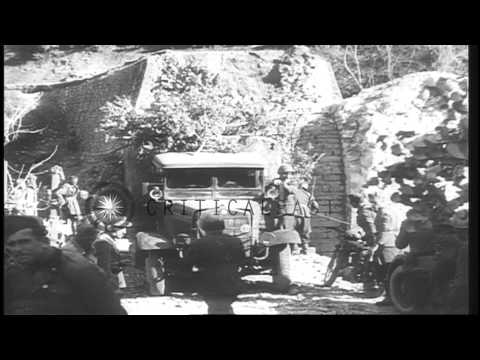 Italy invades Greece as bombs are dropped and Premier Metaxas reviews troops in G...HD Stock Footage