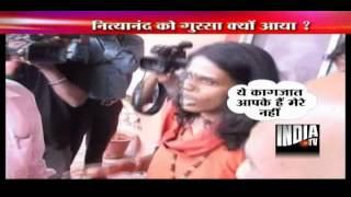 Nityananda flares up on seeing TV reporter  showing summons