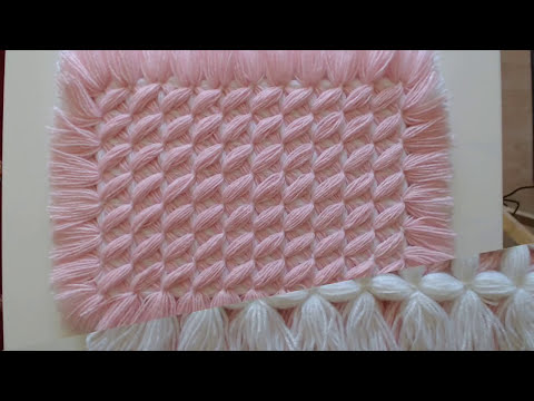 Pom pom blankets.  The CRISS CROSS blanket