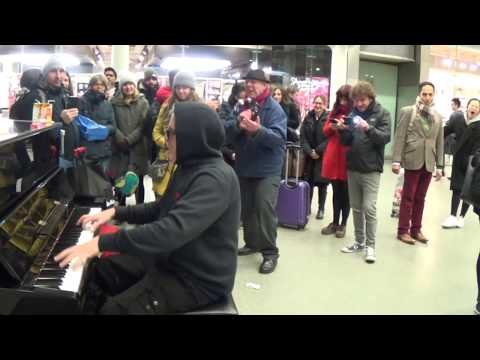 Crowd Digs Christmas Blues at a Public Piano