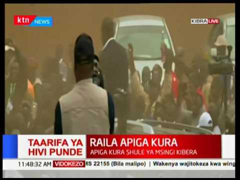 Raila waves at crowds after casting his ballot