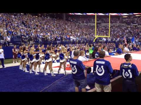 Colts Cheerleaders sing the National Anthem.