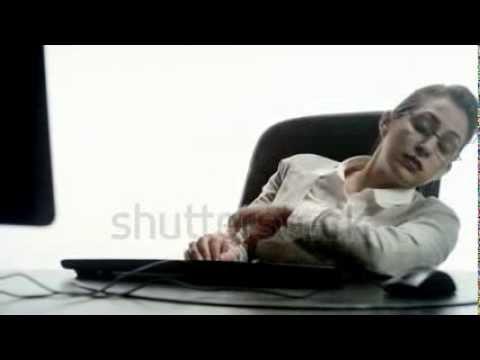 stock footage an hispanic woman falling asleep at a desktop computer