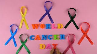 Top view shot - 'World Cancer Day' words surrounded by colorful cancer ribbons