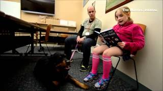 Eight-year-old Ada Reads To Fiona -- A Certified Therapy Dog Through Bright And Beautiful Therapy Do