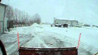 John Deere Skid Steer Loader pushing snow