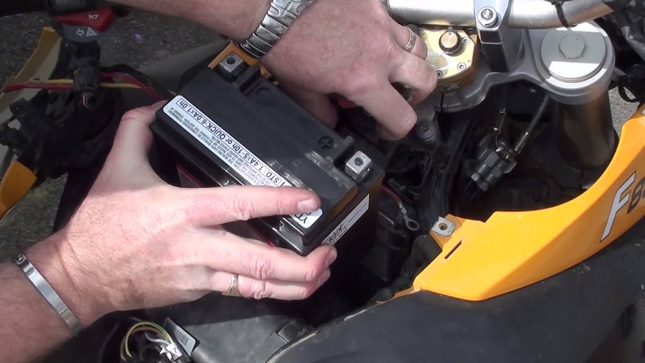 how to change a motorcycle battery bmw f800gs [ 1280 x 720 Pixel ]
