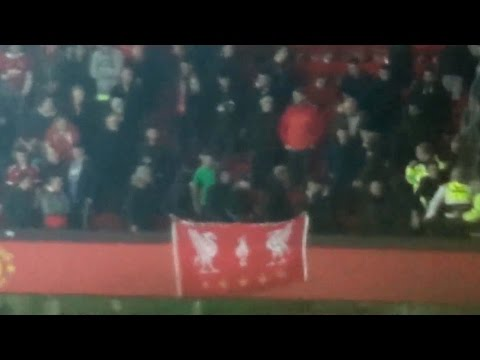 Liverpool Fans Sitting In Manchester United Home Section Unfurl Flag After Goal Resorting In Fights