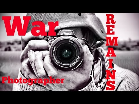 Student Essay comparing War Photographer and Remains by Duff