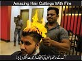 hair cutting with fire by professional barber/hair dresser